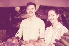 Couple choosing veggies and fruits Stock Photography