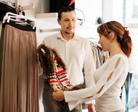 Couple with choosing  vest at clothing shop Stock Image