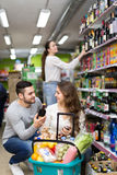 Couple choosing wine and beer Stock Photos