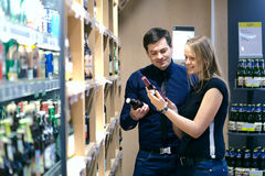 Couple choosing wine in a bottle store Stock Photos