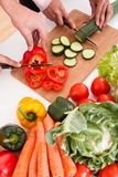 Couple chopping vegetables Royalty Free Stock Images