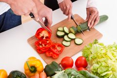 Couple chopping vegetables Royalty Free Stock Photo