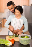 Couple chopping vegetables together stock images