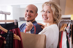 Couple chosing dresses Stock Photography