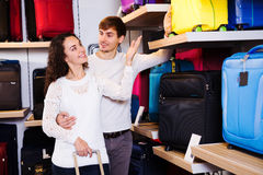 Couple are chosing the handy trunk Royalty Free Stock Images