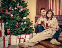 Couple in Christmas decorated house interior Royalty Free Stock Images