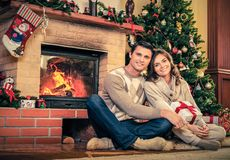Couple in Christmas decorated house interior Royalty Free Stock Photo
