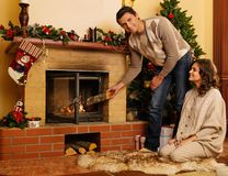 Couple in Christmas decorated house Stock Photo