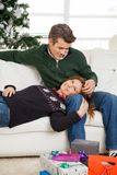 Couple With Christmas Gifts On Floor Relaxing On Royalty Free Stock Image