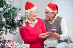 Couple With Christmas Gifts Looking At Each Other Royalty Free Stock Photography