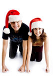 Couple with christmas hat and looking at camera Royalty Free Stock Images