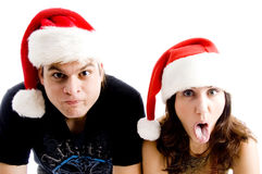 Couple with christmas hat and making faces Royalty Free Stock Images