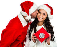 Couple with christmas hats holding red gift box Stock Images