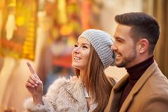 Couple in a christmas market stock photography