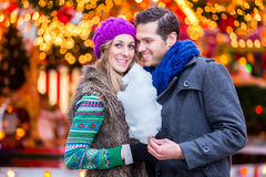 Couple on Christmas market eating cotton candy Royalty Free Stock Image