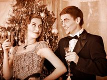 Couple on Christmas party.  Black and white retro. Couple on party near Christmas tree. Black and white retro Royalty Free Stock Images