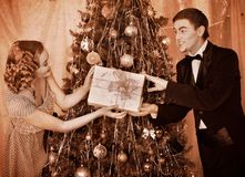 Couple on Christmas party.  Black and white retro. Couple on party near Christmas tree. Black and white retro Royalty Free Stock Image