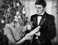Couple on Christmas party. Black and white retro. stock photos