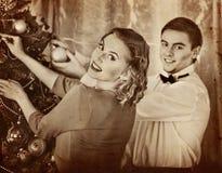 Couple on Christmas party. Black and white retro. Stock Photos