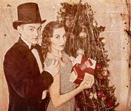 Couple on Christmas party. Black and white retro. Royalty Free Stock Images