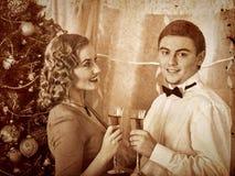 Couple on Christmas party. Stock Photos