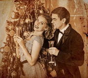 Couple on Christmas party.Sepia toned. Couple on party near Christmas tree. Sepia toned Royalty Free Stock Photos