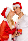Couple at Christmas with Santa Claus hats Royalty Free Stock Photos