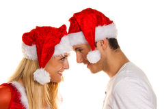 Couple at Christmas with Santa Claus hats Stock Image