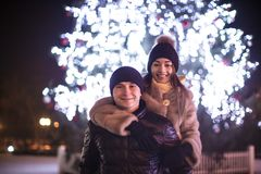 Couple and The Christmas tree Stock Image