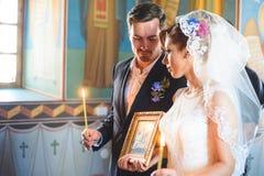 Couple at Church Ceremony Stock Photo