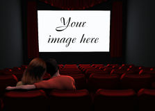 Couple in cinema. Cinema with place for your image on screen Royalty Free Stock Photo