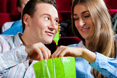 Couple in cinema with popcorn Royalty Free Stock Image
