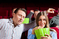 Couple in cinema with popcorn Royalty Free Stock Photos