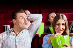 Couple in cinema with popcorn Royalty Free Stock Photography