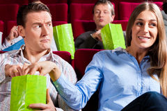 Couple in cinema theater with popcorn Royalty Free Stock Image