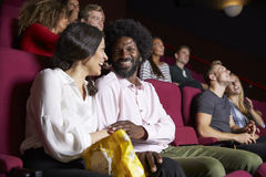 Couple In Cinema Watching Comedy Film Royalty Free Stock Photography