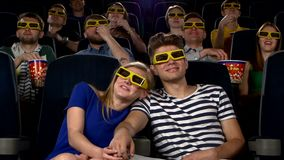 Couple in cinema watching a movie with 3D glasses stock video footage