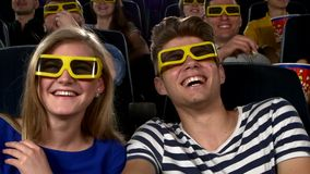 Couple in cinema watching a movie with 3D glasses stock footage