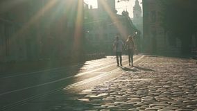 Couple in the city in the early morning stock footage