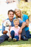 Couple in city park with son and dog Stock Photos