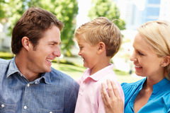 Couple in city park with young son Royalty Free Stock Photos