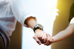 Couple clasp hand together stock photography