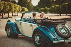 Couple in a classic car Royalty Free Stock Image