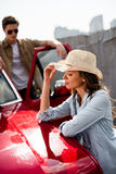 Couple with classical car. Beautiful young couple with classical car Royalty Free Stock Photography