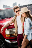 Couple with classical car. Beautiful young couple with classical car Royalty Free Stock Photos