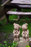 Couple clay dolls on the wall. There are couple of angle clay dolls put on the wall stock photo