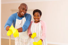 Couple cleaning apartment Royalty Free Stock Images