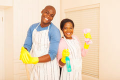 couple cleaning bedroom Royalty Free Stock Photos