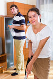 Couple cleaning flat together Royalty Free Stock Image
