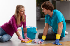 Couple cleaning floor Royalty Free Stock Images